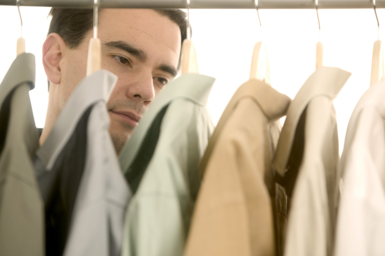 Man Shopping for Dress Shirts