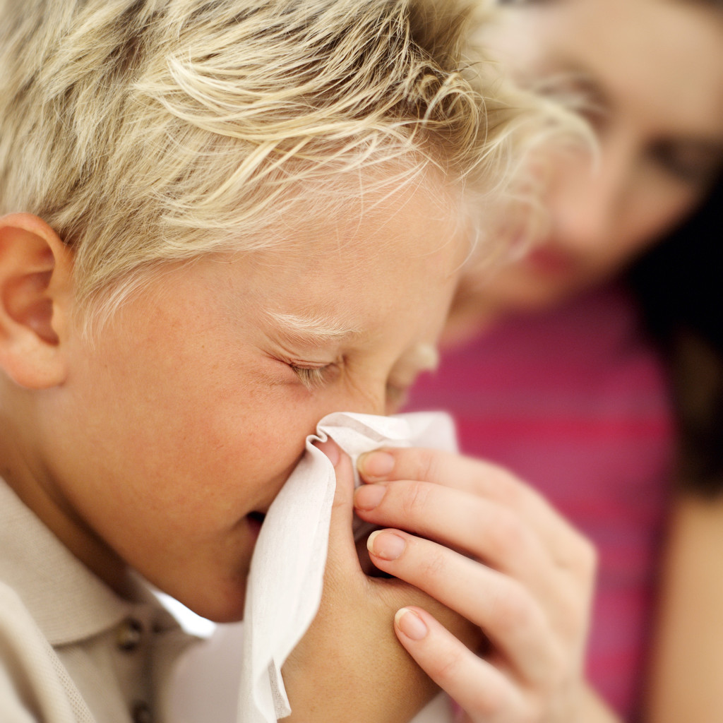 Boy Blowing His Nose into a Handkerchief
