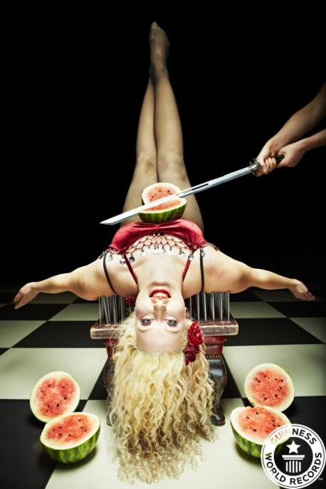 Daniella D'Ville  Johnny Strange - Most melons chopped on the stomach on bed of nails